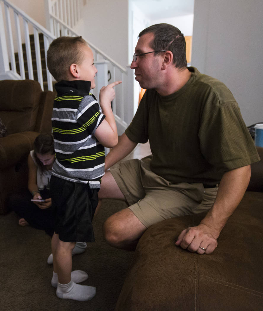 Matt Minkowsky, right, jokes with his son Brandon, 6, at their home in northwest Las Vegas on Wednesday, Sept. 20, 2017. Matt currently has stage 2 brain cancer, and also underwent surgery to drai ...