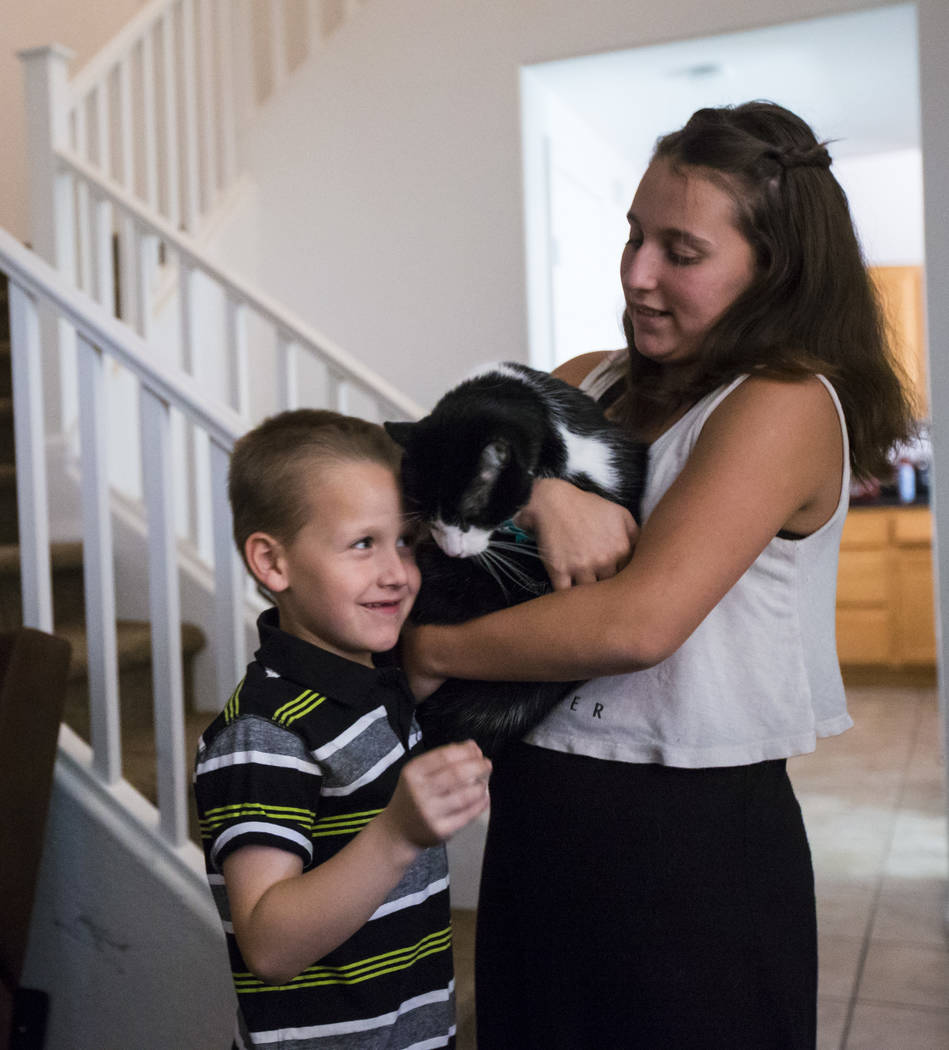 Six-year-old Brandon Minkowsky, left, with his sister Tiffani, 14, and cat, Socks, at their home in northwest Las Vegas on Wednesday, Sept. 20, 2017. Chase Stevens Las Vegas Review-Journal @csstev ...