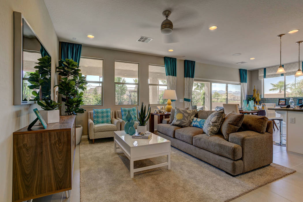 Century Communities' Residence 2288 model features an island kitchen overlooking a great room and dining nook. (Smith Team of Keller Williams)
