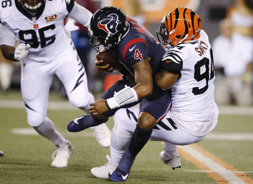 Cincinnati Bengals defensive end Chris Smith (94) sacks Houston Texans quarterback Deshaun Watson (4) during the first half of an NFL football game, Thursday, Sept. 14, 2017, in Cincinnati. (AP Ph ...