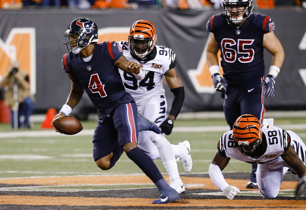 Houston Texans quarterback Deshaun Watson (4) breaks away from Cincinnati Bengals defensive end Chris Smith (94) and linebacker Carl Lawson (58) to score a touchdown during the first half of an NF ...