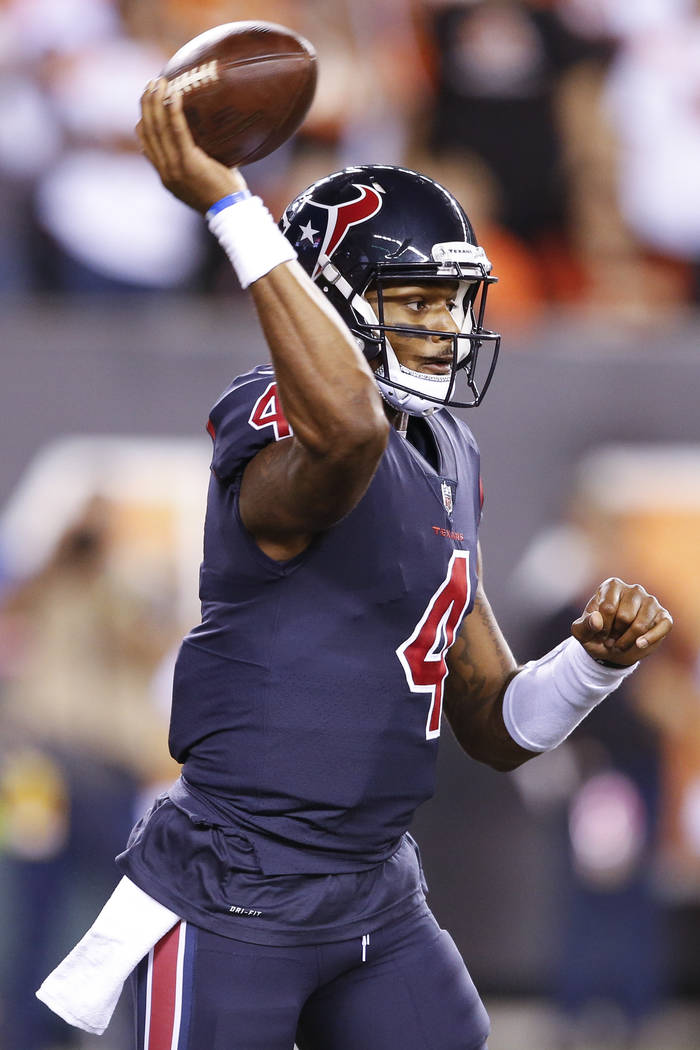Houston Texans quarterback Deshaun Watson passes in the first half of an NFL football game against the Cincinnati Bengals, Thursday, Sept. 14, 2017, in Cincinnati. (AP Photo/Gary Landers)