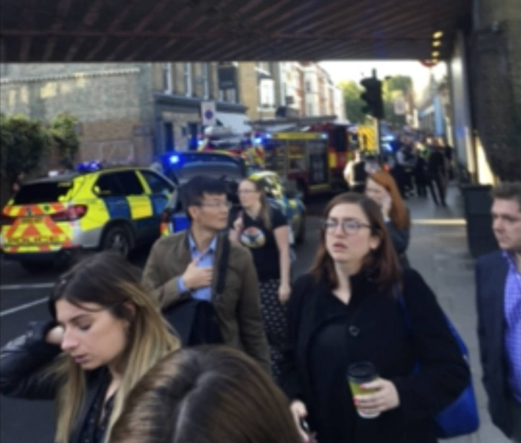 CORRECTS SOURCE - People leave the scene of an explosion at a southwest London subway station in London Friday, Sept. 15, 2017. London's Metropolitan Police and ambulance services are confirming t ...
