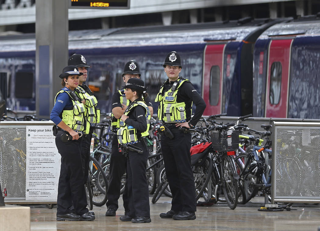 Police provide security at Paddington mainline train station in London, after a terrorist incident was declared at nearby  Parsons Green subway station Friday, Sept. 15, 2017. A bucket wrapped in  ...