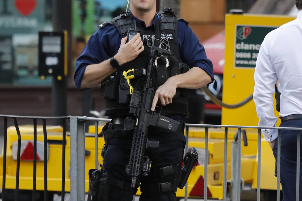 An armed police officer stands nearby after an incident on a tube train at Parsons Green subway station in London, Friday, Sept. 15, 2017. A reported explosion at the train station sent commuters  ...