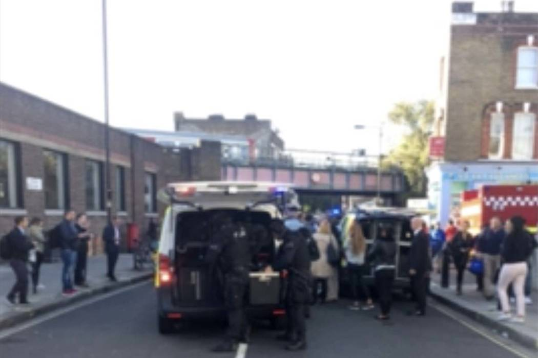 Police officers stand at the scene of a southwest London subway station after an explosion in London Friday, Sept. 15, 2017. London's Metropolitan Police and ambulance services are confirming they ...