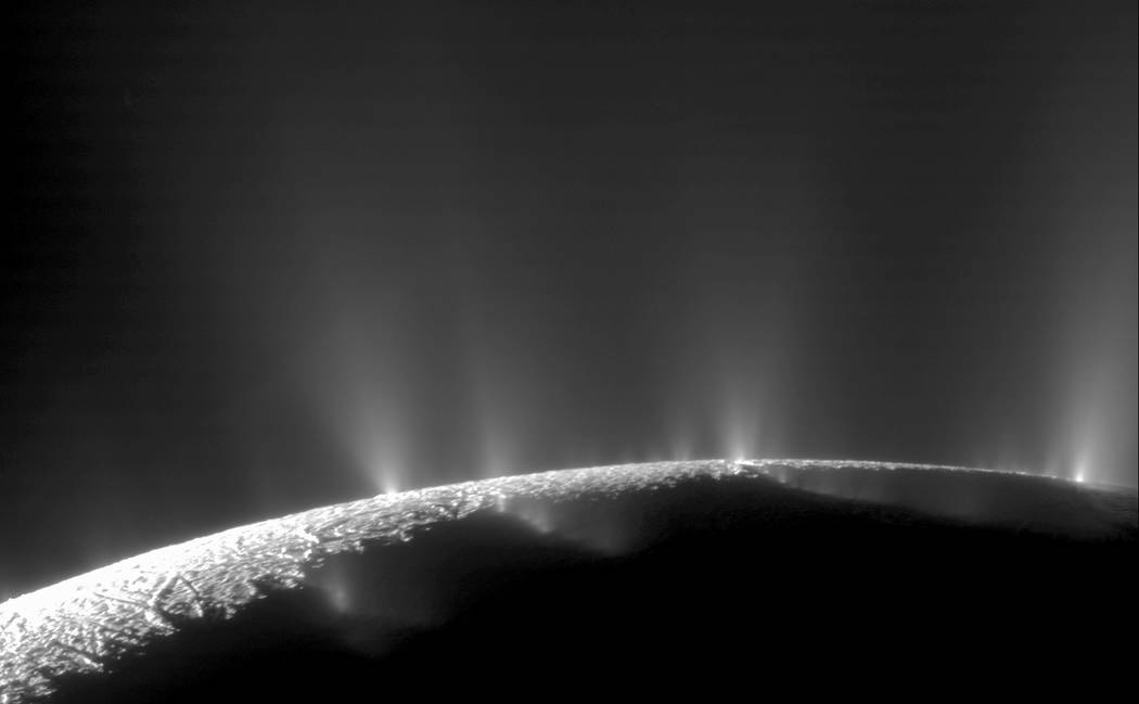 This Feb. 17, 2005 image made available by NASA shows plumes of water ice and vapor from the south polar region of Saturn's moon Enceladus. The activity is understood to originate from the moon's  ...