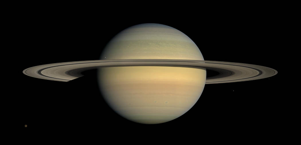 This July 23, 2008, image made available by NASA shows the planet Saturn, as seen from the Cassini spacecraft. After a 20-year voyage, Cassini is poised to dive into Saturn on Friday, Sept. 15, 20 ...
