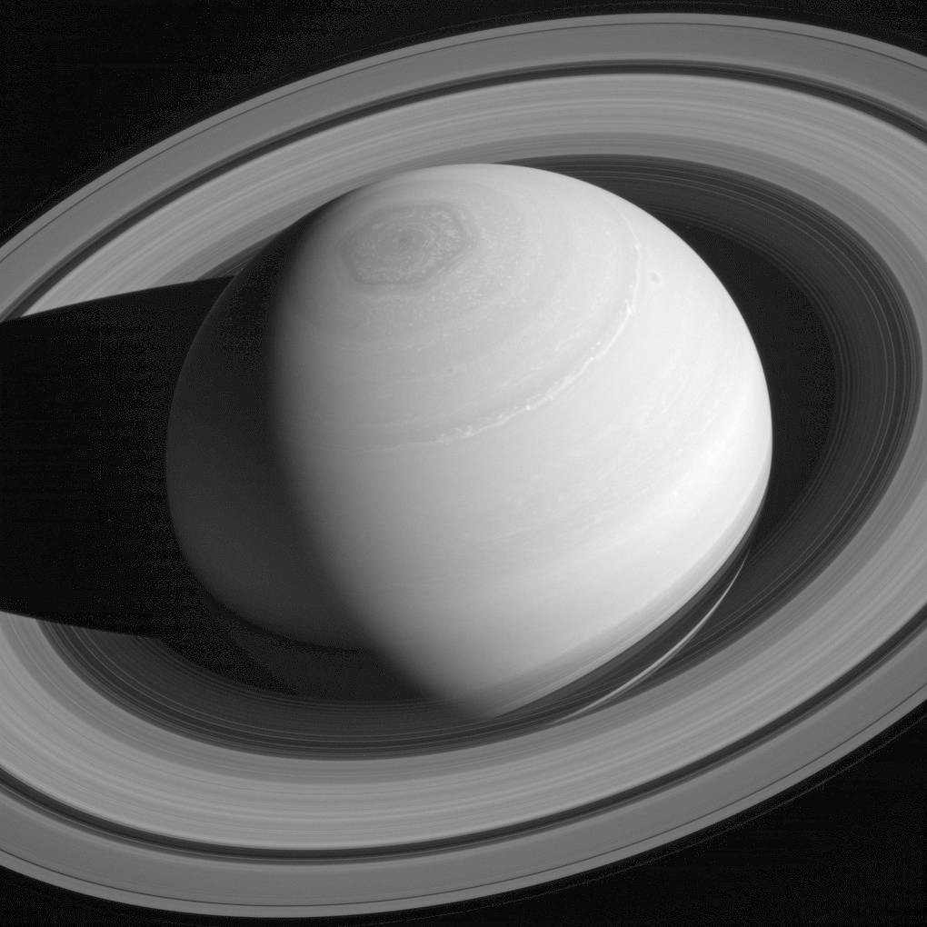 This May 4, 2014, image made available by NASA shows the persistent hexagonal cloud pattern on Saturn's north pole, as seen from the Cassini spacecraft. The hexagon is similar to Earth's polar vor ...