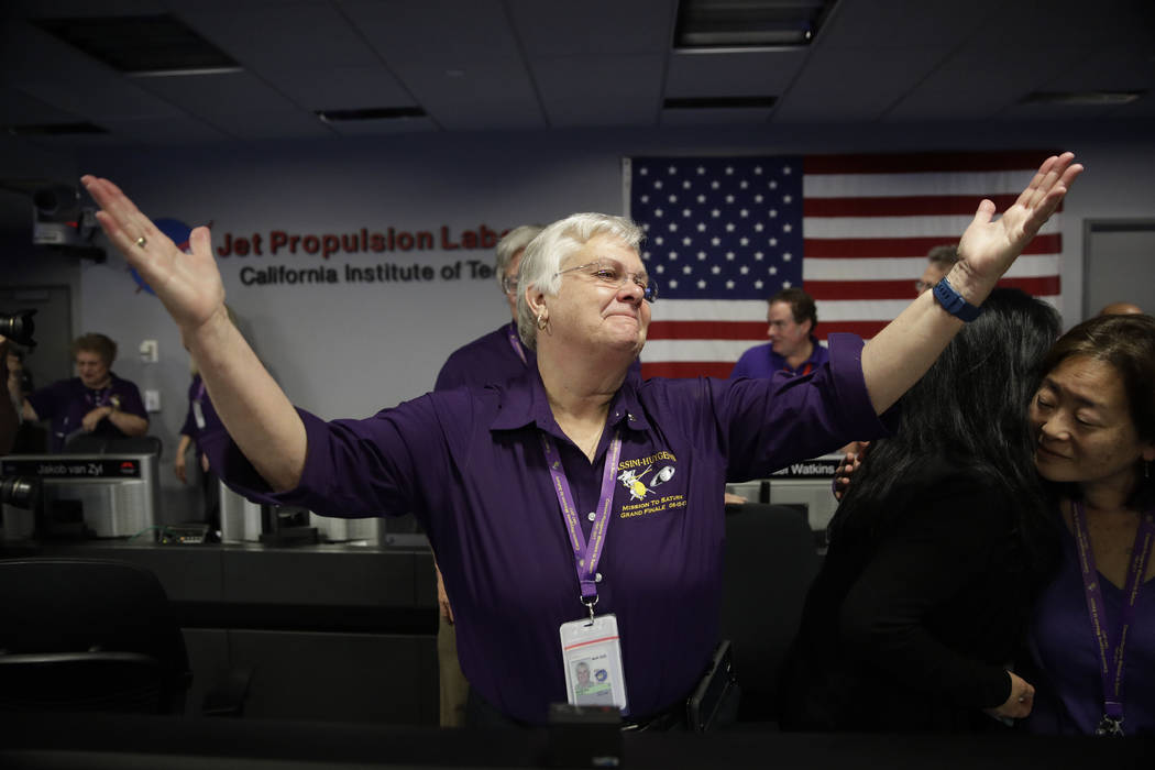 Flight director Julie Webster reacts in mission control at NASA's Jet Propulsion Laboratory after confirmation of Cassini's demise Friday, Sept. 15, 2017, in Pasadena , California. Cassini disinte ...