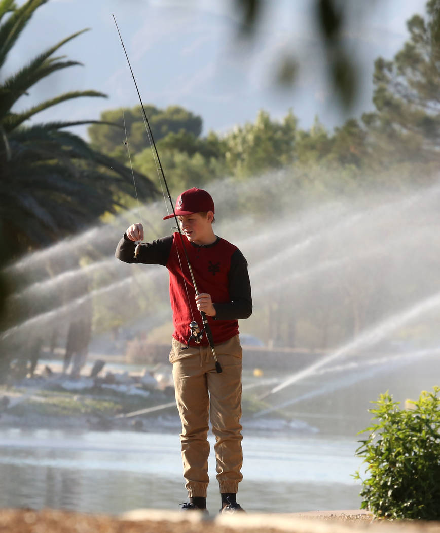 Gavin Black enjoys his morning fishing at Sunset Park on Friday, Sept. 15, 2017, in Las Vegas. (Bizuayehu Tesfaye/Las Vegas Review-Journal) @bizutesfaye