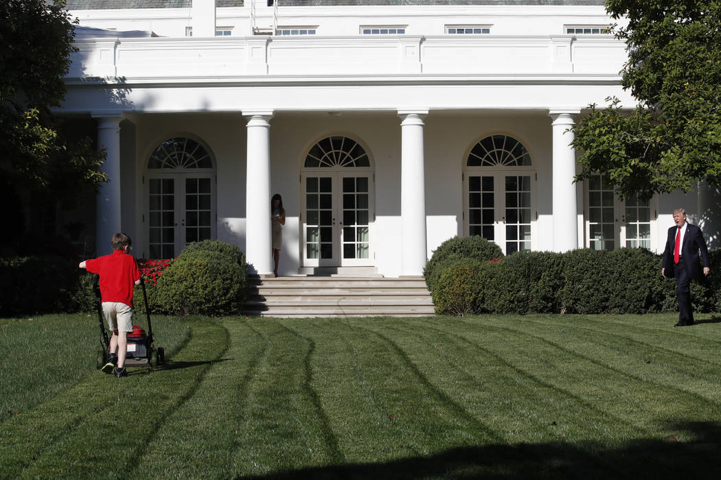 Frank Giaccio, 11, of Falls Church, Virginia, is surprised by President Donald Trump, right, Friday, Sept. 15, 2017, while mowing the lawn of the Rose Garden at the White House in Washington. The  ...