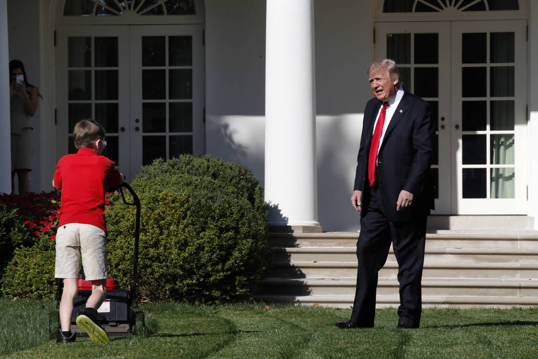 Frank Giaccio, 11, of Falls Church, Virginia, is surprised by President Donald Trump, Friday, Sept. 15, 2017, as he mows the lawn of the Rose Garden at the White House in Washington. The 11-year-o ...