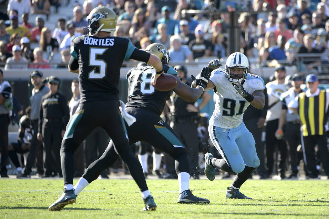 Jacksonville Jaguars quarterback Blake Bortles (5) throws a pass as offensive tackle Jermey Parnell (78) blocks against Tennessee Titans outside linebacker Derrick Morgan (91) during the second ha ...