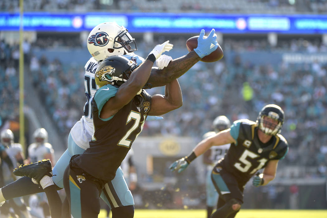 Jacksonville Jaguars cornerback Prince Amukamara (21) breaks up a pass intended for Tennessee Titans tight end Delanie Walker (82) during the second half of an NFL football game in Jacksonville, F ...