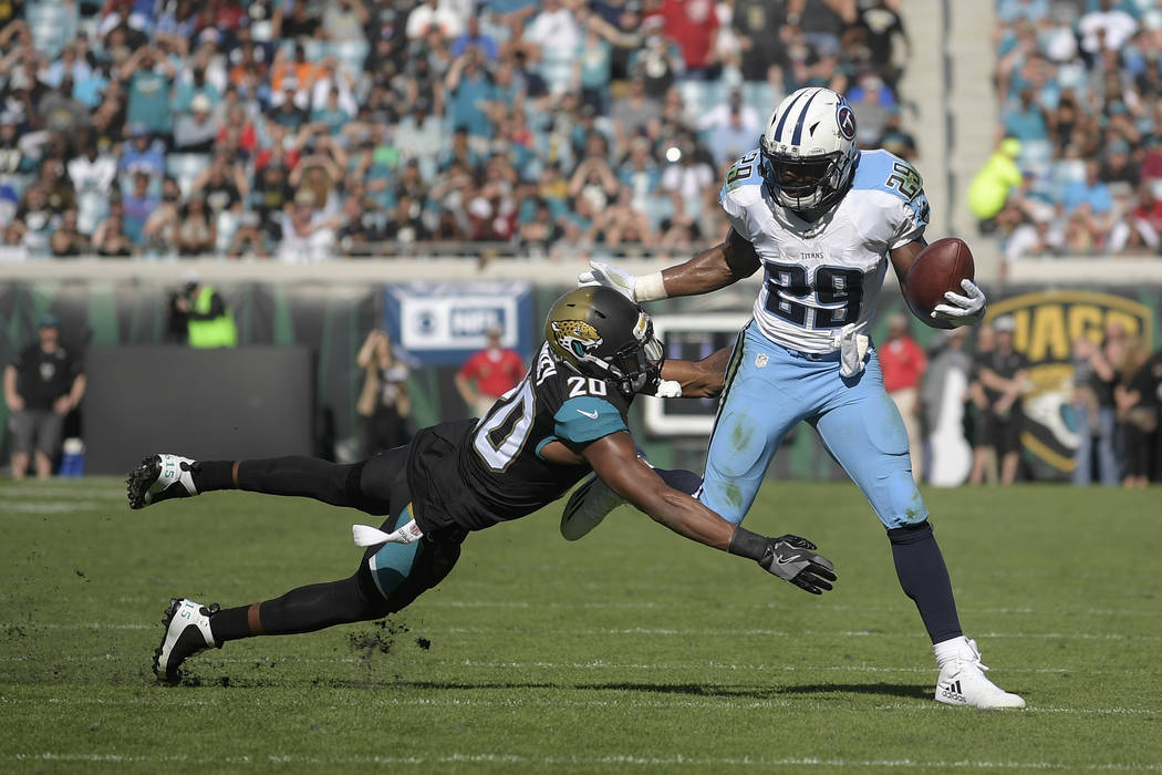 Tennessee Titans running back DeMarco Murray (29) rushes for yardage in front of Jacksonville Jaguars cornerback Jalen Ramsey (20) during the first half of an NFL football game in Jacksonville, Fl ...