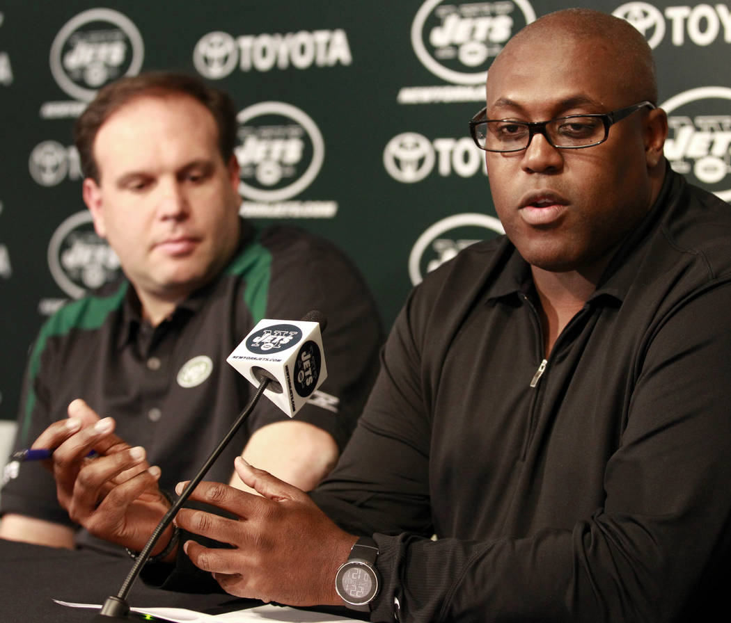 New York Jets vice president and college scouting executive Joey Clinkscales, right, is seen next to general manager Mike Tannenbaum during a pre-draft news conference at the team's training facil ...