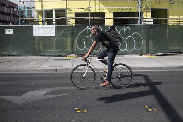 A bicyclist rides near Fremont Street and 7th Street on Tuesday, May 24, 2016, in Las Vegas. Erik Verduzco Las Vegas Review-Journal Follow @Erik_Verduzco