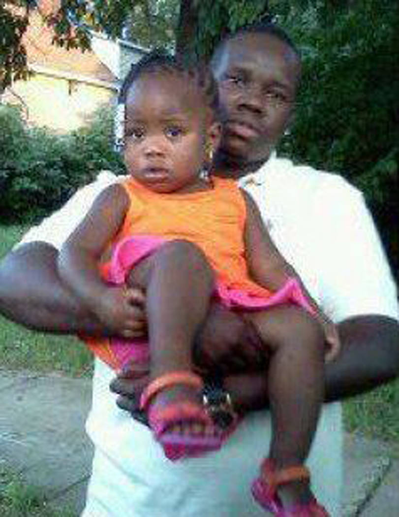 This undated family photo supplied by Christina Wilson shows Anthony Lamar Smith holding his daughter Autumn Smith. Anthony Lamar Smith was killed in 2011 during a confrontation with police. A jud ...