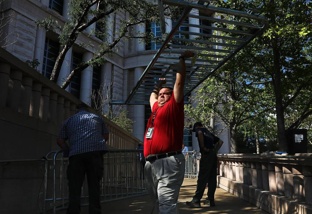 Officials begin erecting barricades outside the Thomas F. Eagleton federal courthouse in St. Louis on Thursday, Sept. 14, 2017, before an expected verdict in the trial of former St. Louis Police o ...