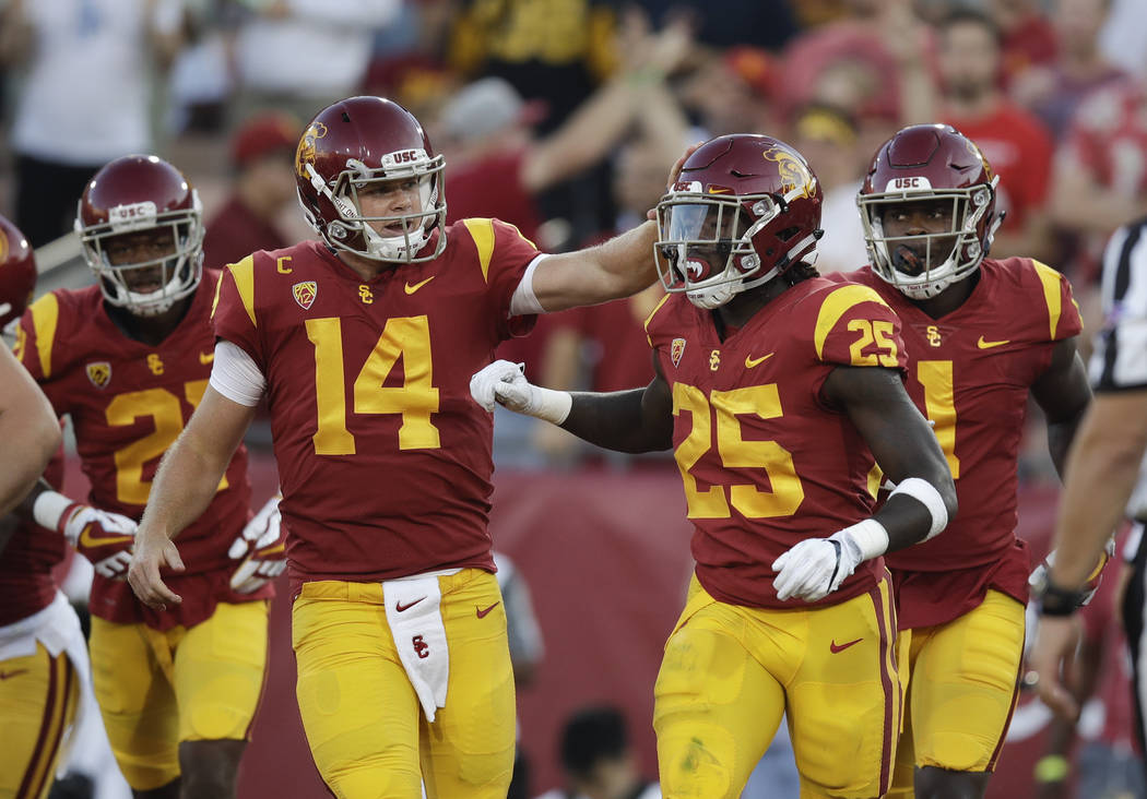 Southern California running back Ronald Jones II, right, is congratulated by quarterback Sam Darnold after scoring a touchdown during the first half of an NCAA college football game against Stanfo ...