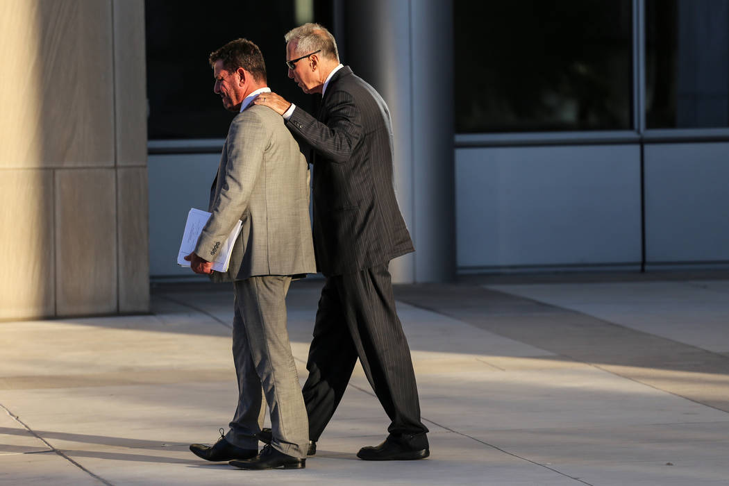 Attorney Todd Leventhal, left, and defendant Edward Levine, right, leave the federal courthouse in Las Vegas, Thursday, Sept. 14, 2017, after receiving a guilty verdict for illegally selling the h ...