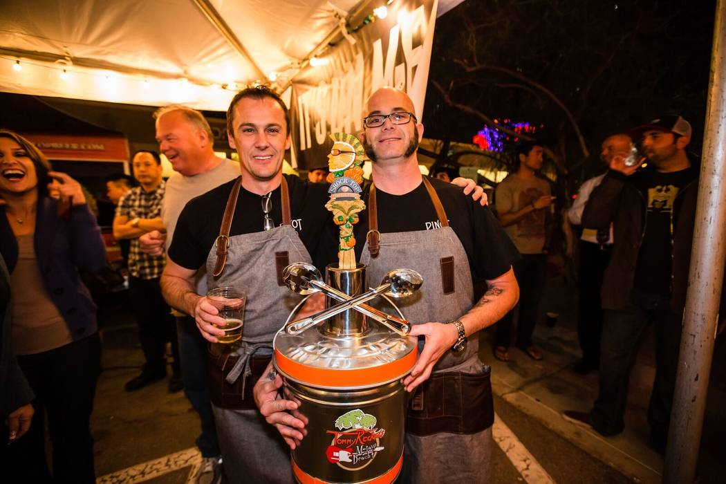 Chefs Eric Lhuillier and John Courtney hold the series' third trophy. (Back of the House Brawl)
