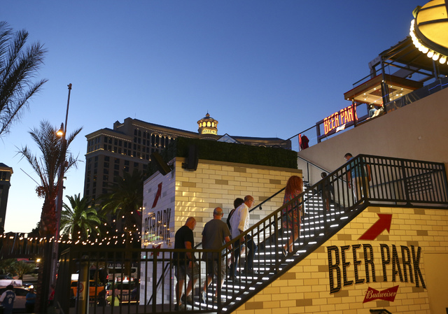 People Make Their Way To Beer Park At The Paris Hotel Casino In Las Vegas