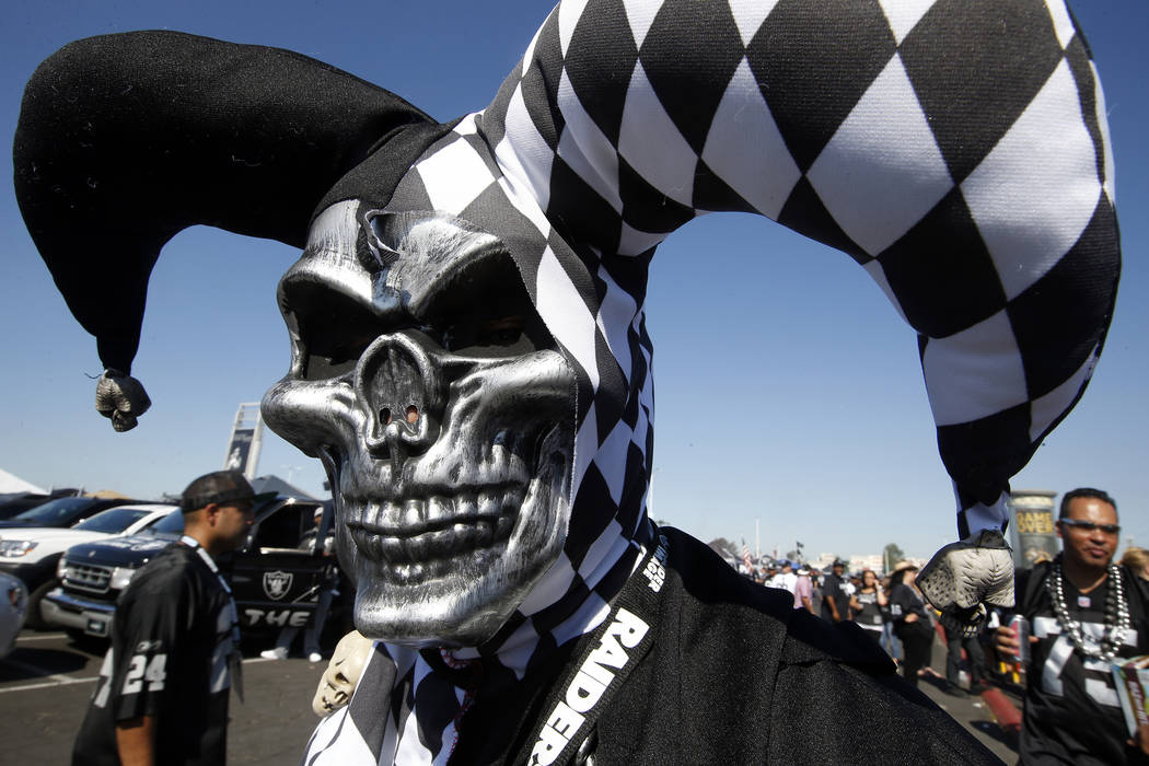 In this Sept. 20, 2015, file photo, fans tailgate before an NFL football game between the Oakland Raiders and the Baltimore Ravens in Oakland, Calif. The sections in the South end zone of Oakland- ...