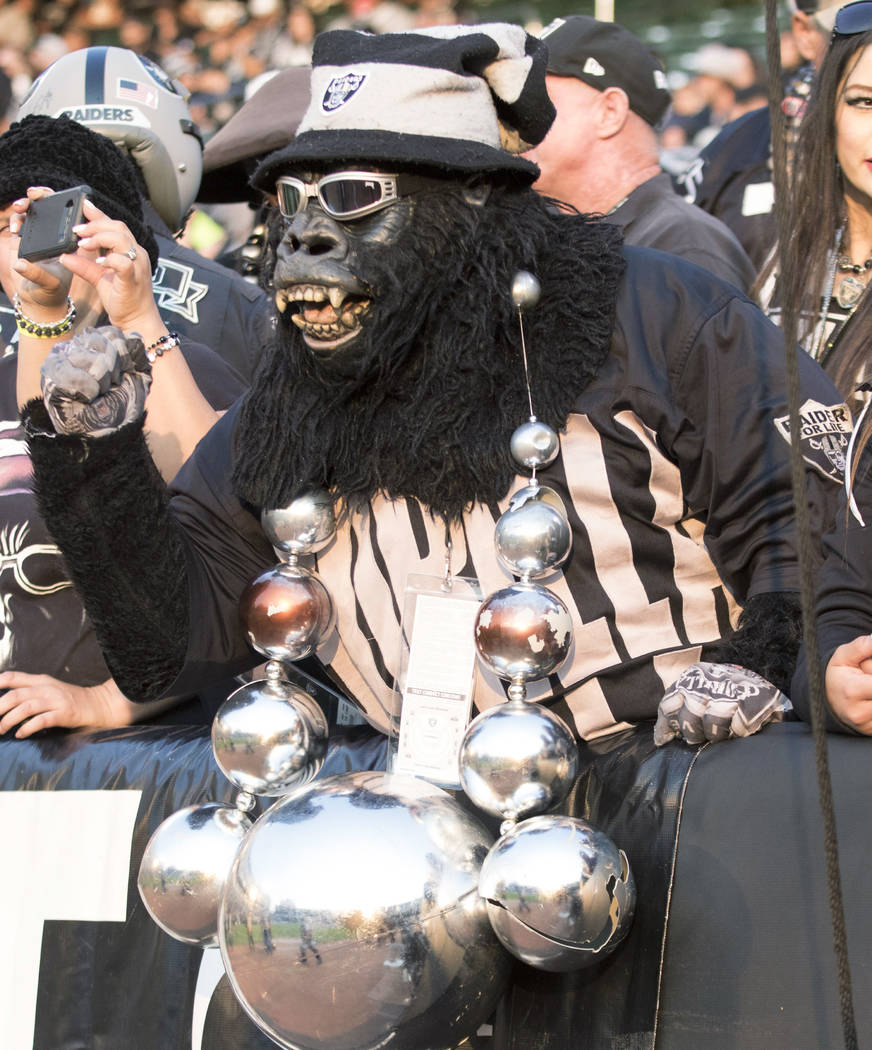 An Oakland Raiders fan cheers on the team from 'The Black Hole' during the first quarter of a NFL preseason football game against the Los Angeles Rams in Oakland, Calif., Saturday, Aug. 19, 2017.  ...