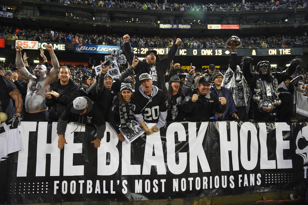 November 20, 2014; Oakland, CA, USA; Oakland Raiders fans celebrate during the second quarter against the Kansas City Chiefs at O.co Coliseum. Mandatory Credit: Kyle Terada-USA TODAY Sports