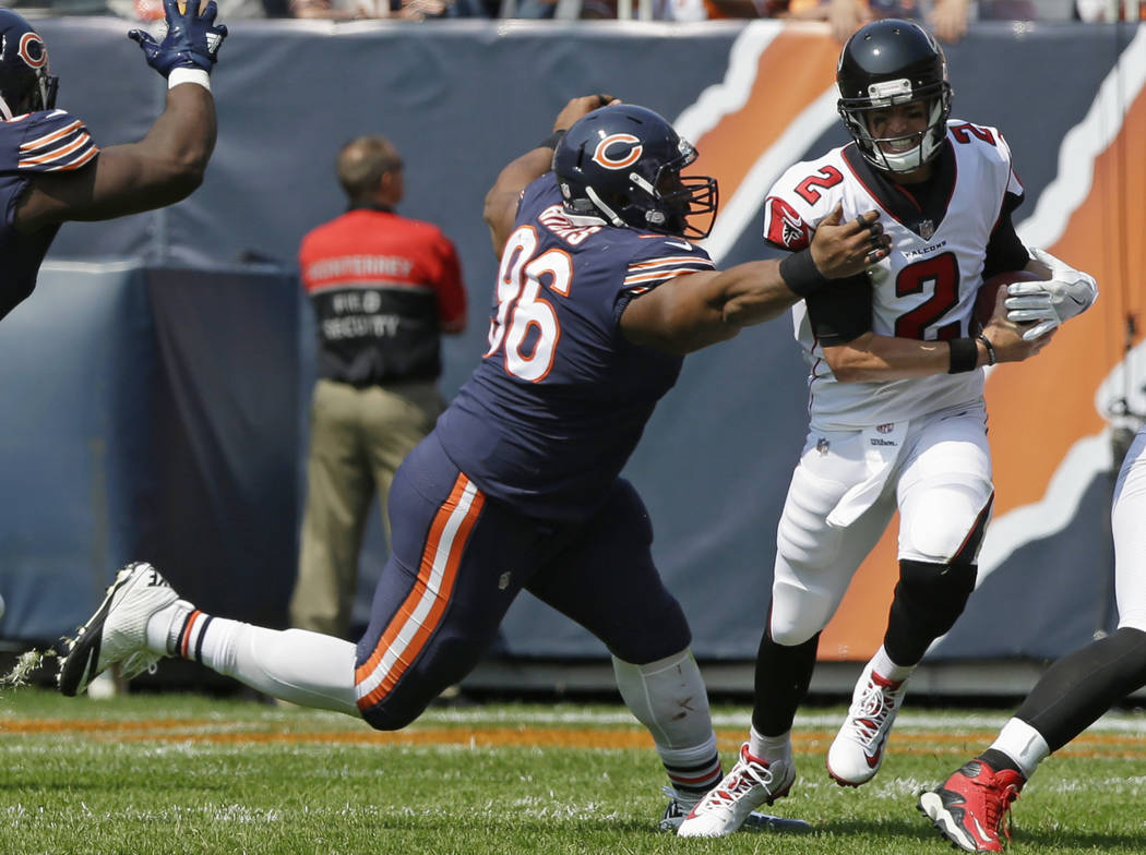 Chicago Bears defensive end Akiem Hicks (96) tries to tackle Atlanta Falcons quarterback Matt Ryan (2) during the second half of an NFL football game, Sunday, Sept. 10, 2017, in Chicago. (AP Photo ...