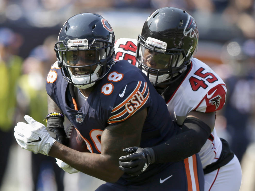 Chicago Bears tight end Dion Sims (88) is tackled by Atlanta Falcons linebacker Deion Jones (45) during the second half of an NFL football game, Sunday, Sept. 10, 2017, in Chicago. (AP Photo/Micha ...