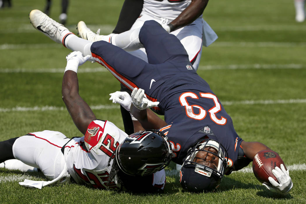 Chicago Bears running back Tarik Cohen (29) dives to the end zone for a touchdown as he is tackled by Atlanta Falcons cornerback Desmond Trufant (21) during the second half of an NFL football game ...