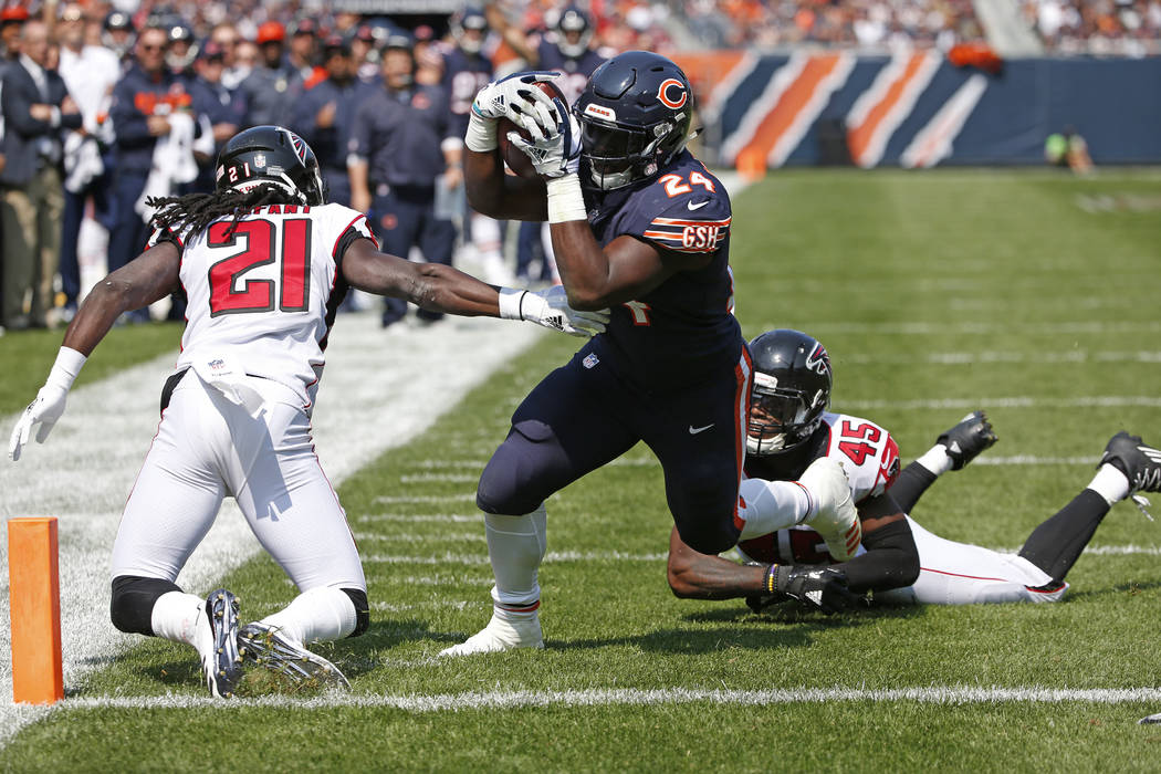 Chicago Bears running back Jordan Howard (24) dives to the end zone form a touchdownagainst Atlanta Falcons cornerback Desmond Trufant (21) and middle linebacker Deion Jones (45) during the first  ...