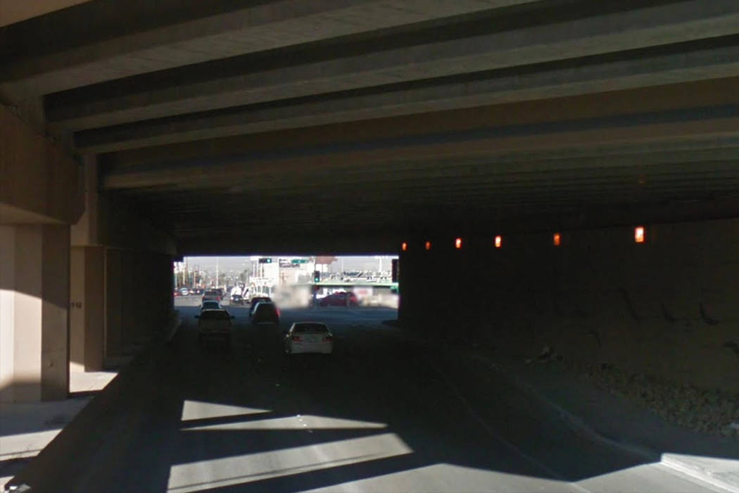 A witness called 911 to report that a man had been stabbed near the freeway underpass at West Bonanza Road and North City Parkway. Google Street View.