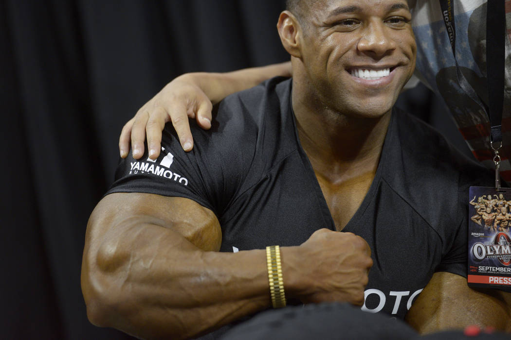 Nathan De Asha flexes his arm while posing for a photo during a Meet the Olympians event with competitors in the Mr. Olympia competition at The Orleans Arena Sept. 14. (Sam Morris/Las Vegas News B ...