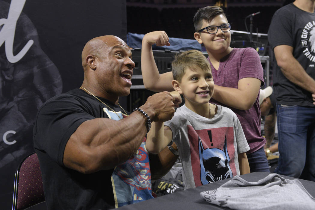Current Mr. Olympia Phil Heath poses for a photo with some young fans during a Meet the Olympians event with competitors in the Mr. Olympia competition at The Orleans Arena Sept. 14. (Sam Morris/L ...