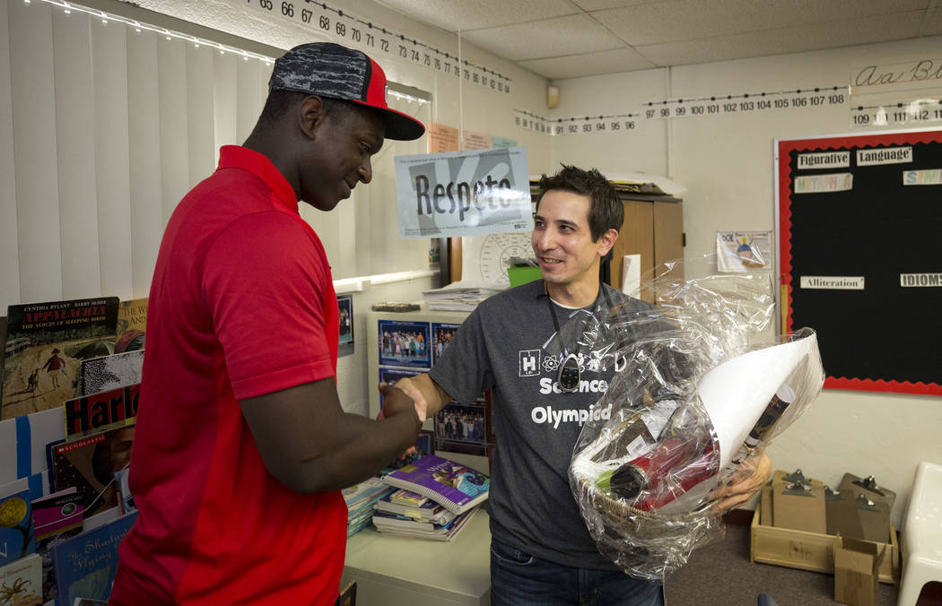 UNLV football player Jalil Briley, left, with his former math teacher Christopher Ho during a surprise visit to his old grade school at Mabel Hoggard Elementary School in Las Vegas on Friday, Sept ...
