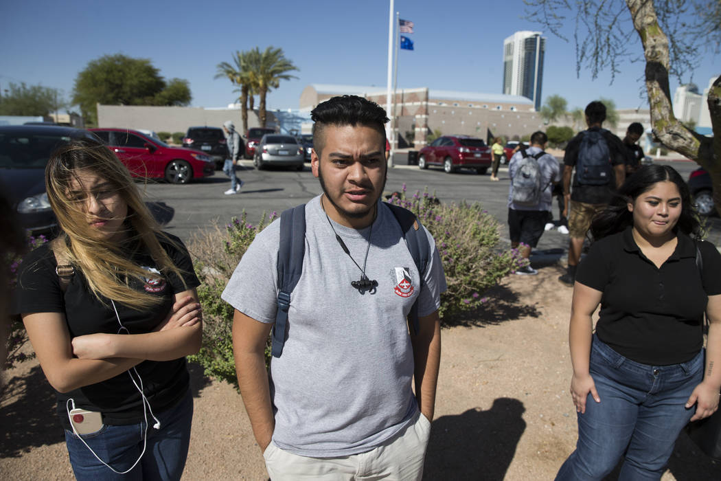 Anthony Ramirez, 17, center, student concerned about budget cuts at Burk Horizon High School, is interviewed outside of his school in Las Vegas, Wednesday, Sept. 20, 2017. The school is facing bud ...