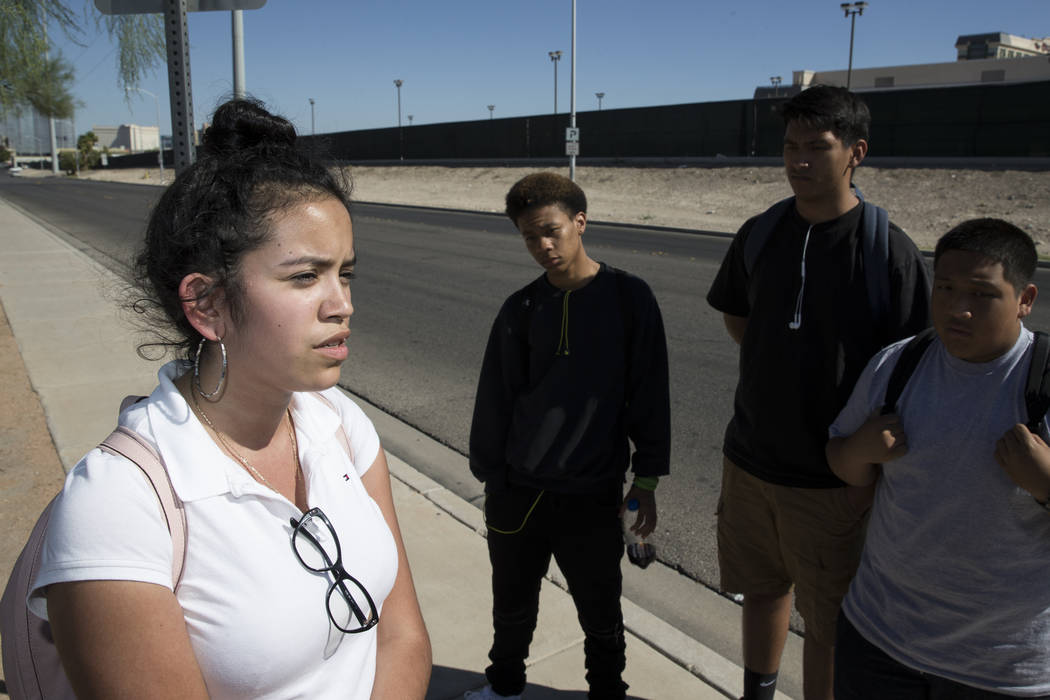 Students at Burk Horizon High School from left, Nez Garduno-Padilla, 18, is interviewed on budget cuts to her school as her classmates Naseem Evans, 18, Juan Rios, 17, and Eduardo Juc, 16, stand i ...