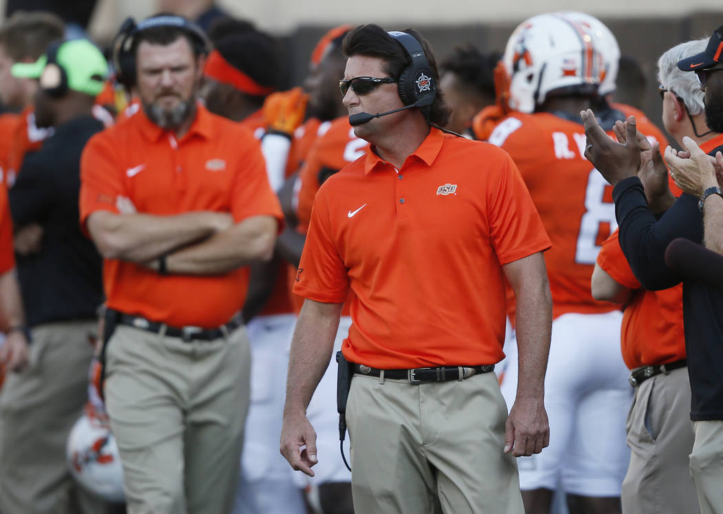 Oklahoma State head coach Mike Gundy is pictured during an NCAA college football game between Tulsa and Oklahoma State in Stillwater, Okla., Thursday, Aug. 31, 2017. (AP Photo/Sue Ogrocki)