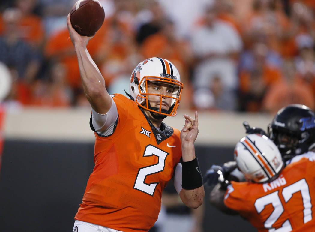 Oklahoma State quarterback Mason Rudolph (2) throws during an NCAA college football game between Tulsa and Oklahoma State in Stillwater, Okla., Thursday, Aug. 31, 2017. (AP Photo/Sue Ogrocki)