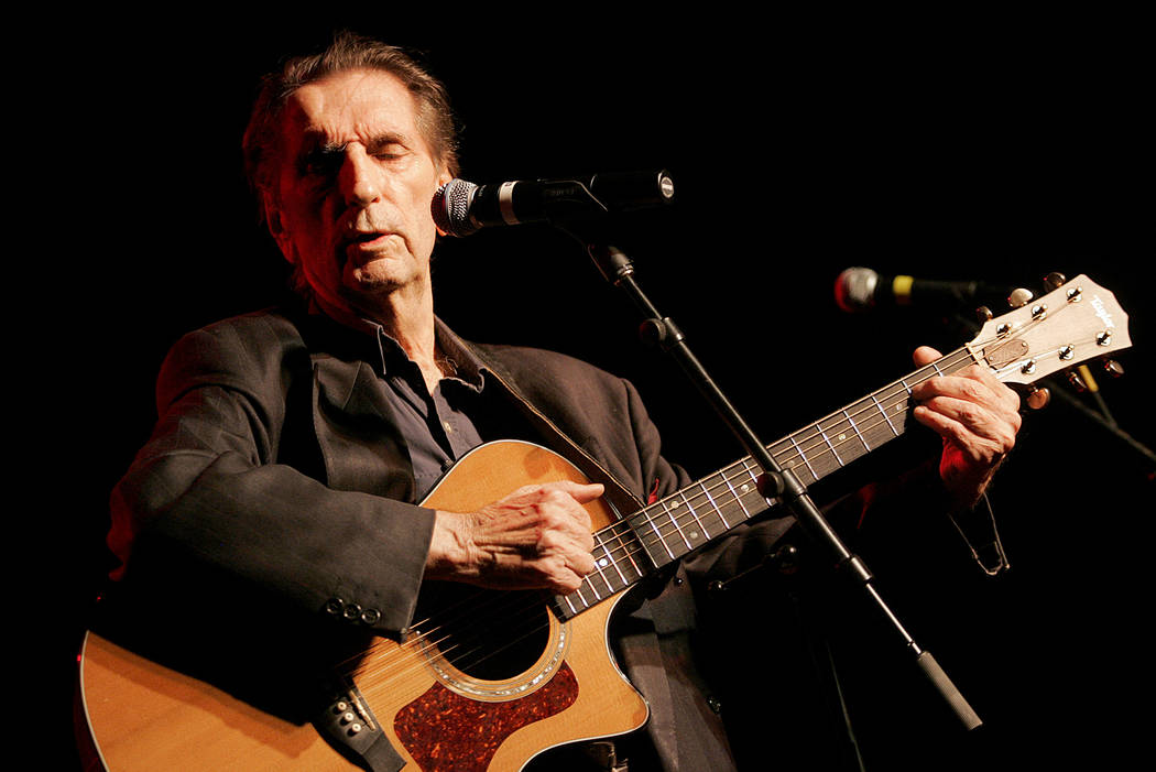Harry Dean Stanton performs at the 35th anniversary celebration of the founding of Greenpeace, in Los Angeles in 2006. (AP Photo/Jae C. Hong, File)