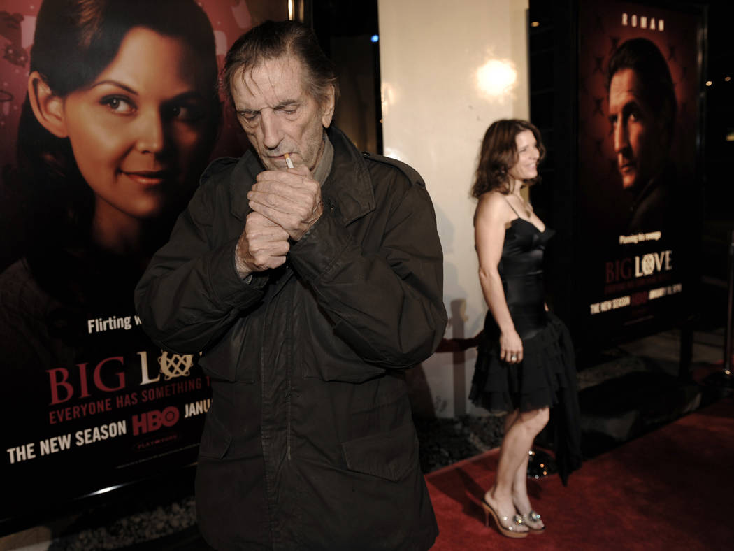 "Harry Dean Stanton, left, a cast member in the HBO series ""Big Love,"" lights a cigarette as fellow cast member Melora Walters poses on the red carpet at the show's third season premiere in Los Ang ..."