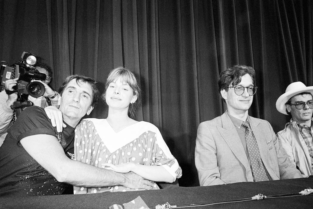 Harry Dean Stanton, left, and German actress, Nastassja Kinski embrace during a photo session at the 37th Cannes Film Festival in 1984. (AP Photo/Michel Lipchitz, File)