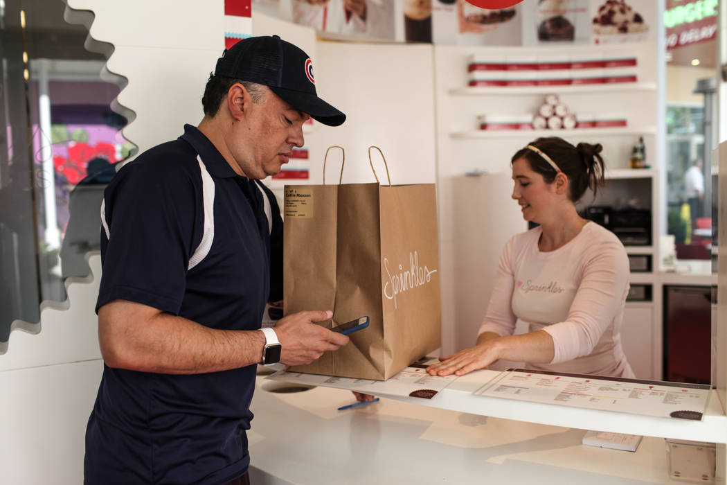 Rick Lewis, a driver for same-day delivery service Dropoff, picks up a package from Sprinkles located in The Linq Hotel Monday, Sept. 18, 2017 for delivery in Las Vegas. (Joel Angel Juarez/Las Veg ...