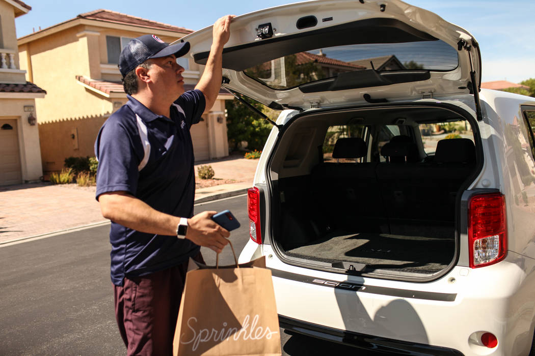 Rick Lewis, a driver for same-day delivery service Dropoff, delivers a package from Sprinkles located in The Linq Hotel Monday, Sept. 18, 2017 in Las Vegas. (Joel Angel Juarez/Las Vegas Review-Jou ...