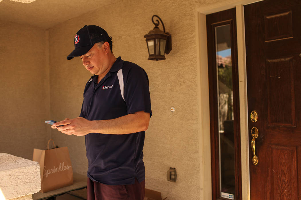 Rick Lewis, a driver for same-day delivery service Dropoff, delivers a package from Sprinkles located in The Linq Hotel Monday, Sept. 18, 2017 in Las Vegas. The Dropoff platform, both an app and a ...
