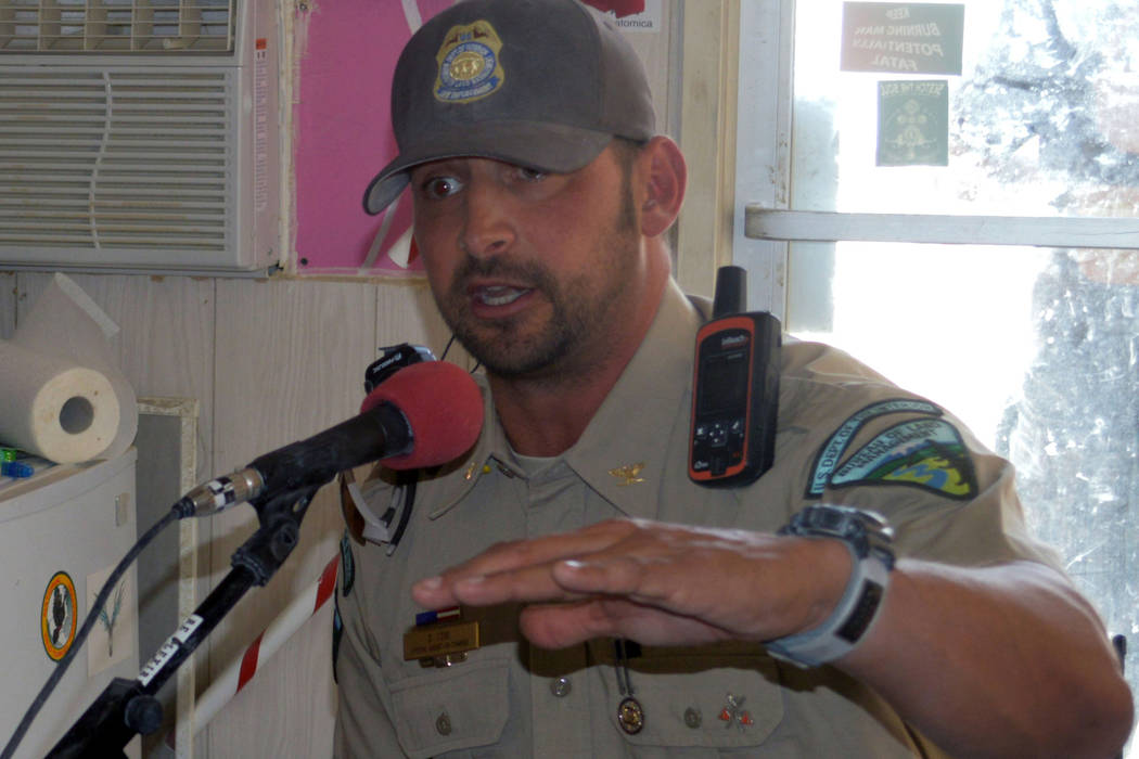 Dan Love, special agent in charge for the the Bureau of Land Management in Nevada and Utah, gives a radio interview during the Burning Man festival in 2015.  (BLM Nevada on Flickr)